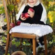 Adorable little girl with apples, autumn time — Stock Photo #55619055
