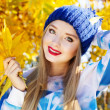 Autumn woman happy with colorful fall leaves — Stock Photo #55906169