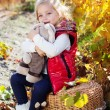 Little girl in warm clothes with toy rabbit — Stock Photo #56063903