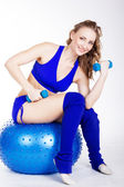 Young woman is sitting on the fit-ball — Stock Photo