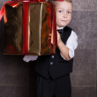 Little boy with Cristmas gift — Stock Photo #56918649