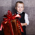 Little boy with Cristmas gift — Stock Photo #56921787