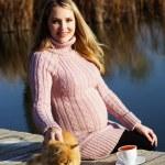 Pregnant woman on the autumn lake — Stock Photo #57177723