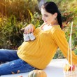Pregnant woman on the nature, autumn time — Stock Photo #57267251