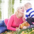Mother and son near lake with pumpkin, autumn time — Stock Photo #57533595
