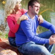 Young couple near lake with pumpkin, autumn time — Stock Photo #57533759
