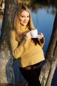 Pregnant woman on the autumn lake — Stock Photo