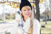 Attractive blonde girl with wearing warm clothes — Stock Photo