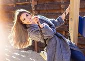 Young fashion girl having fun on swing — Stock Photo