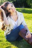 Young pretty teenager girl sitting on green grass — Stock Photo