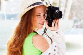 Nice girl photographer at work — Stock Photo