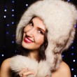 Pretty smiling girl in a furry winter hat — Stock Photo #61131227