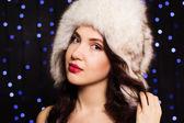 Pretty smiling girl in a furry winter hat — Zdjęcie stockowe
