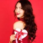 Beautiful woman holding gift box — Stock Photo #61176463