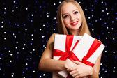 Beautiful teenager girl holding white gift box — Stok fotoğraf