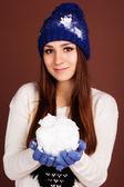 Teenager girl is holding snowball — Fotografia Stock