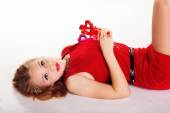 Beautiful girl in red dress holding hearts — Stock Photo