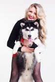 Young girl with her husky dog isolated on white — Stock Photo