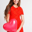 Beautiful girl is holding red heart balloons — Stock Photo #62264501
