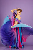 Beautiful belly dancer wearing a purple costume — 图库照片