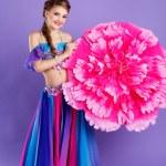 Beautiful belly dancer wearing a purple costume — Stock Photo #62809545