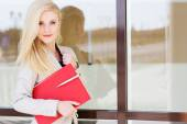 Young beautiful girl with a red folder and books — Stock Photo