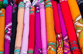 Various of colorful Indian fabrics in market — Stock Photo