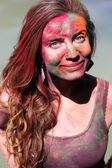 Portrait of happy girl with paint on her face — Stok fotoğraf