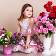 Little girl with nice spring roses — Stock Photo #68393405