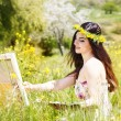 Painter woman is create picture outdoors — Stock Photo #72266501