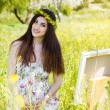 Painter woman is create picture outdoors — Stock Photo #72266547