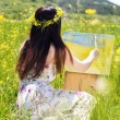 Painter woman is create picture outdoors — Stock Photo #72266781