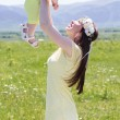 Couple mother and her baby on the camomile meadow — Stock Photo #75016175