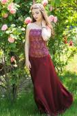 Beautiful woman is wearing fashion dress in park — Stock Photo