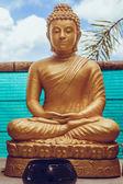 Sitting golden Buddha statue in Thailand — Stock Photo