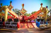 Colorful carousel with sundown — Stock Photo