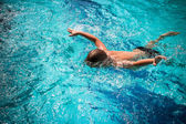 Activities on pool, boy swimming and playing in water. Koh Samui — Stock Photo