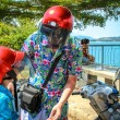 Father and son wearing helmets are going to go on a motorbike in Koh Samui — Stock Photo #53125001