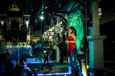 Koh Samui, Thailand, 2013, 2 April Woman with Microphone sings in night restaurant — Stock Photo
