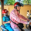 Father and son wearing helmets are going to go on a motorbike in Koh Samui — Stock Photo #55163867