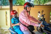 Father and son wearing helmets are going to go on a motorbike in Koh Samui — Stock Photo