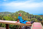 Happy boy at sky with beautiful landscape — Stock Photo