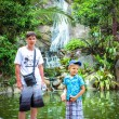 Father and son near the waterfall in Koh Samui mountains — Stok fotoğraf #55488601