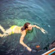 Young woman snorkeling in blue and transparent tropical sea — Stock Photo #55698669