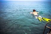 Snorkeler in the sea near boat. Beautiful seascape. — Stock Photo