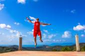 Happy jumping man on the mountain — Stock Photo