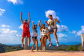 Funny friends fooling around in the mountains — 图库照片