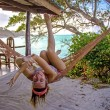 Woman posing at romantic hammock in private house near tropical beach — Stock Photo #57042299