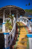 Steps leading to the gazebo under  roof — Stock Photo