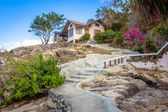 Natural stone stairs leading to house on  cliff — Stock Photo